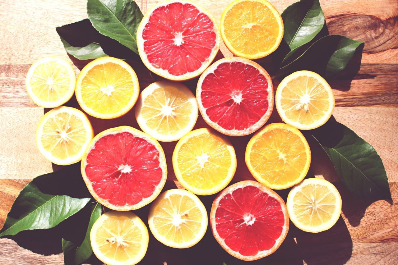Citrus Fruit Lemon SLICE Fruit Healthy Eating Cross Section Lime Grapefruit Food And Drink Freshness High Angle View Halved Variation Food No People Blood Orange Choice Multi Colored Indoors  Day