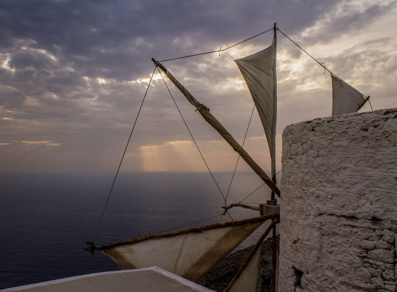 Sailboat By Sea Against Sky During Sunset