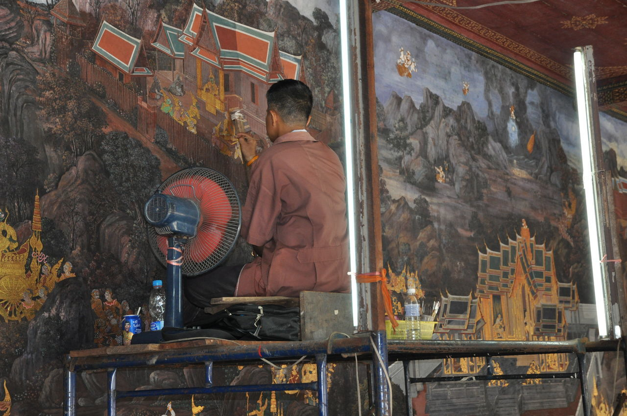 Restoration of a wall mural in Wat Phra Kaeo Adult Adults Only Archival Art Day Grand Palace Bangkok Thailand Historical Place Indoors  Man At Work Men One Man Only One Person Only Men Painting People Rear View Renovation Restoration Wall Murals Wat Phra Kaeo Working Art Is Everywhere Break The Mold