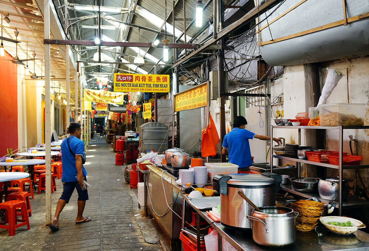 Market in Kuala Lumpur, Malaysia, Asia Adult Business Business Finance And Industry Commerce Factory Indoors  Industry Malaysia Manual Worker Market Men Occupation People Senior Adult Teamwork Working