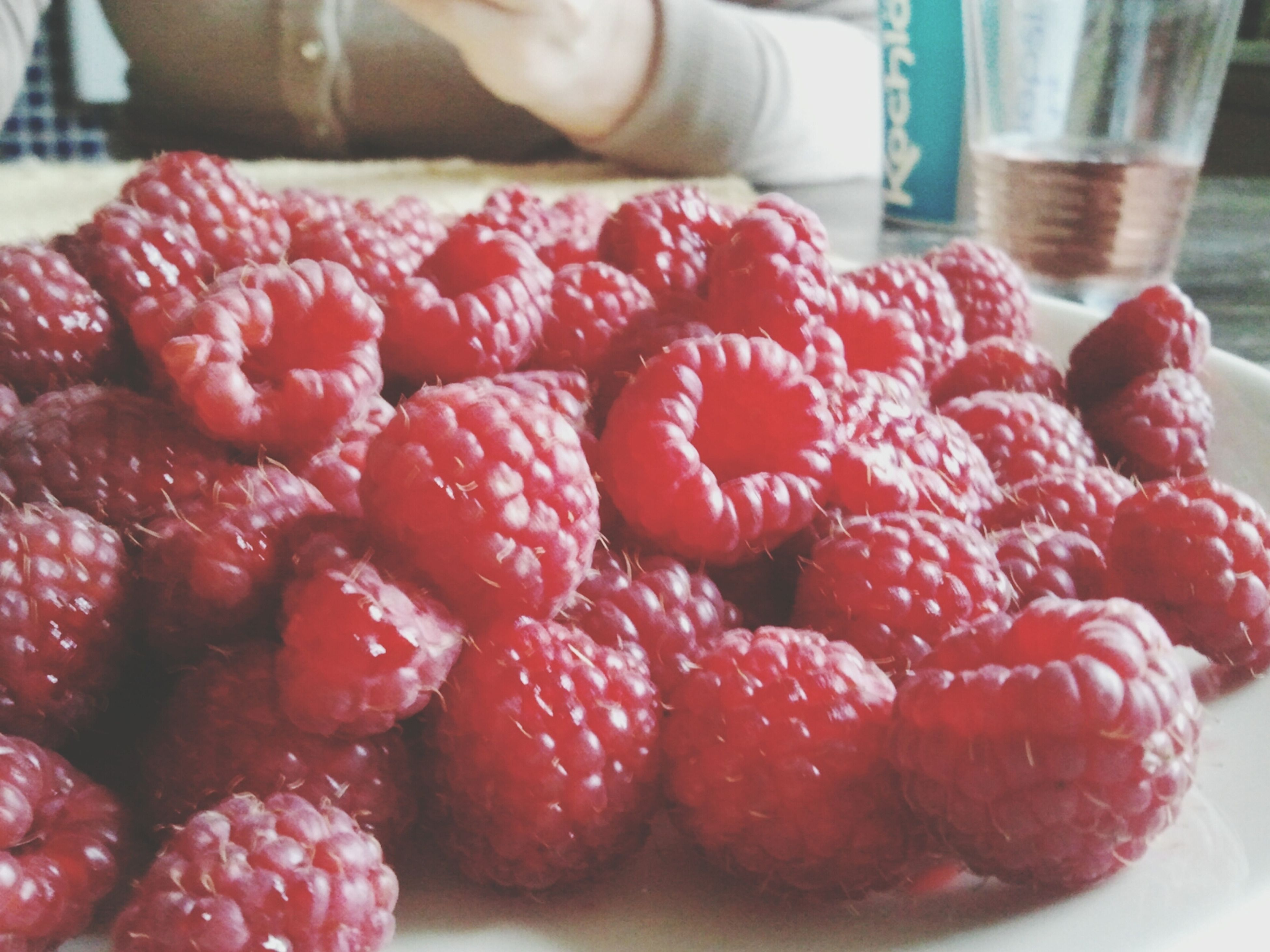 food and drink, red, food, indoors, freshness, fruit, strawberry, healthy eating, close-up, still life, focus on foreground, sweet food, berry fruit, raspberry, abundance, glass - material, large group of objects, dessert, indulgence, berry