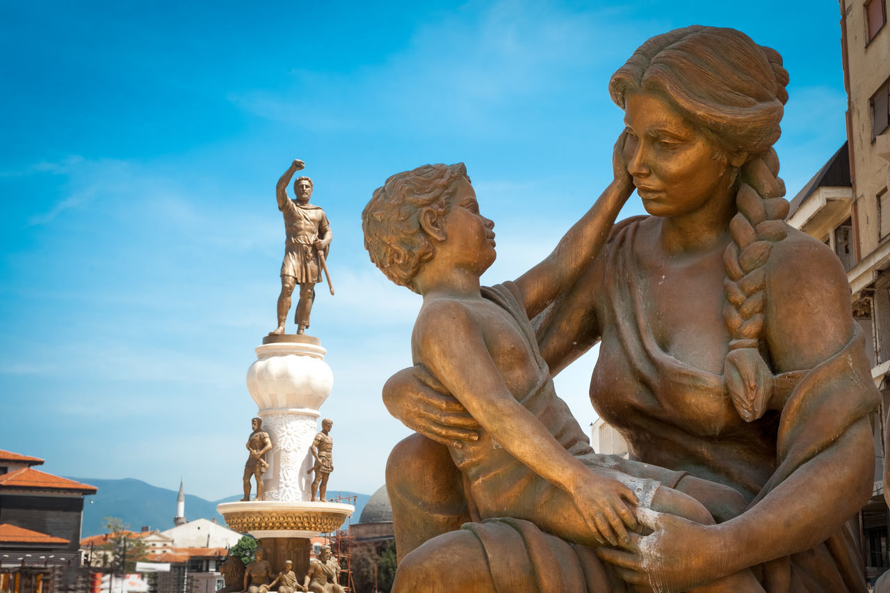 Statue of mother & son and statue of Alexander the Great in background, in center of Skopje, Macedonia (FYROM)
