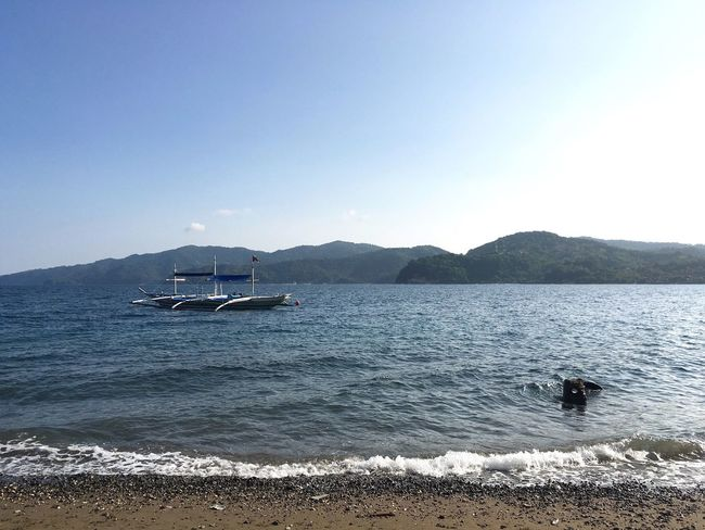Blue seas, blue skies... A way to calm troubled hearts Beach Beauty In Nature Boats Philippines Anilao, Batangas Sand Ocean View