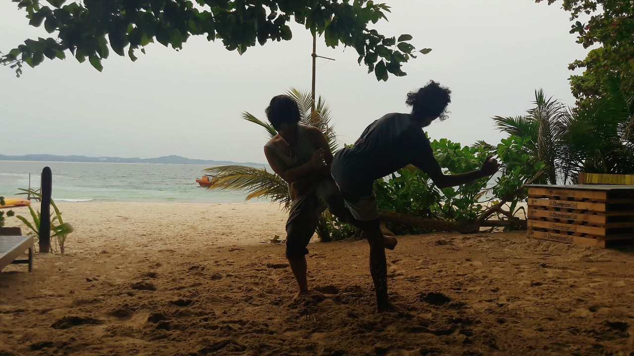 Sea Two People Beach Full Length People Sand Adventure Real People Adults Only Happiness Lifestyles EyeEm Market © Malaysia Truly Asia Silhouette Horizon Over Water Men Fight Boxe Thai Fighting Fightclub Competition Eyeem Market Eyeem Sport Sport Sports Photography