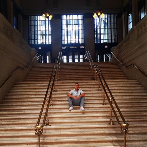 "Young male sitting on ""The Untouchables"" staircase at Union Station, Chicago. Chigago Adult Adults Only Architecture Day Full Length Hand Rail Indoors  Leisure Activity Lifestyles Men One Man Only One Person People Real People Sitting Staircase Stairs Steps Steps And Staircases The Untouchables Union Station Chicago Young Adult"