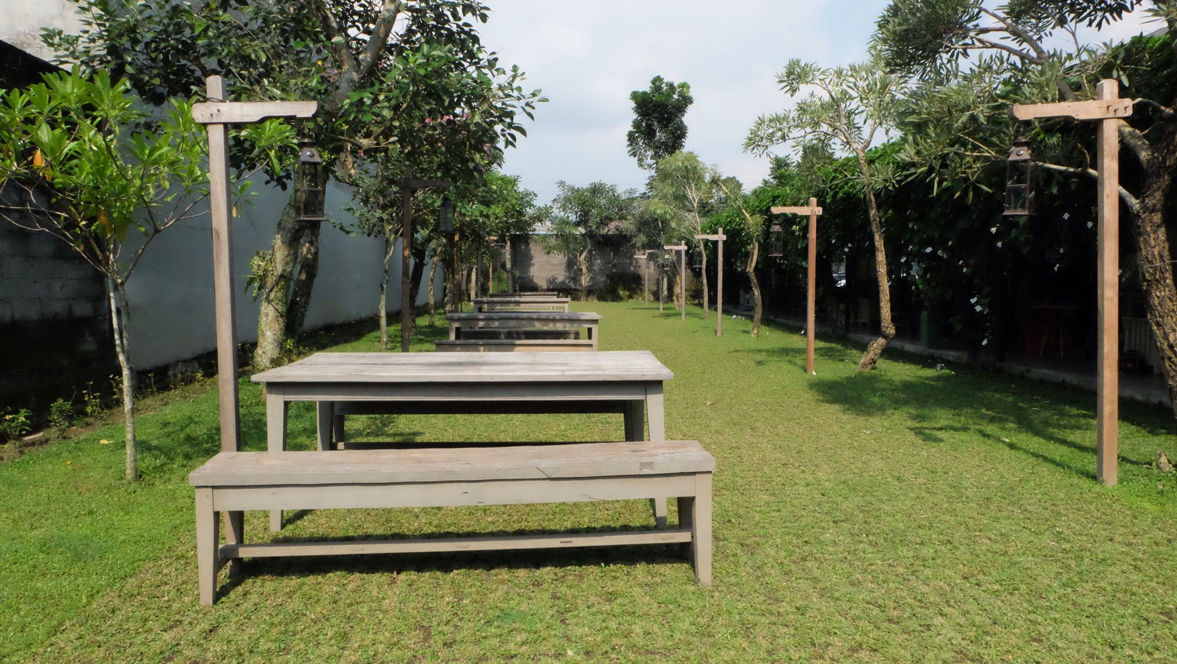 bench, empty, tree, grass, absence, chair, park - man made space, green color, park bench, tranquility, seat, park, growth, nature, lawn, tranquil scene, relaxation, gazebo, table, day