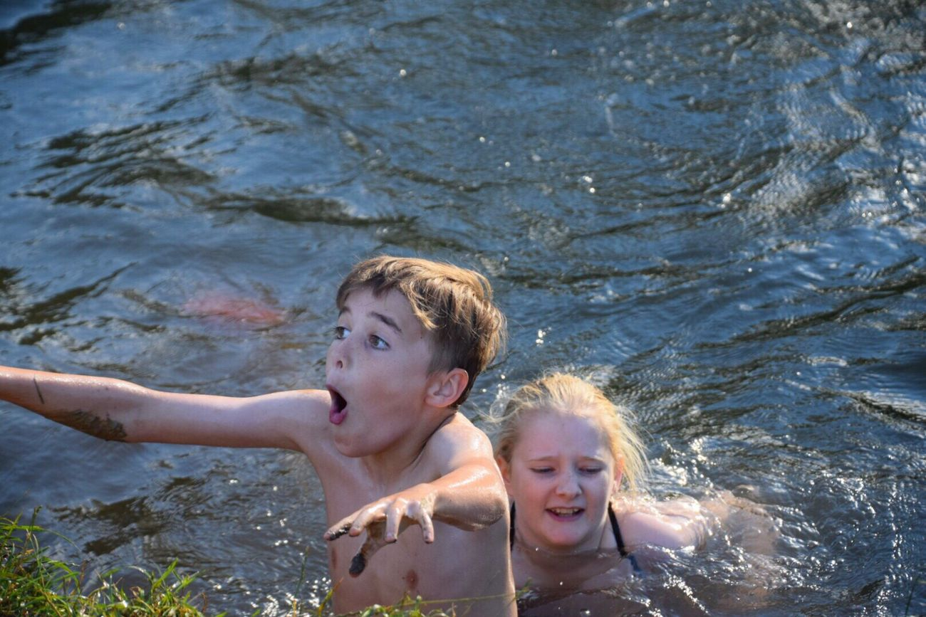 Childhood Child Hot Days Wiltshire Countryside Riverside Photography River Swimming River Family Time River Fun Wiltshire UK Mud Slinging Riverbank Fun Water Friendship Day Sibling Children Only Togetherness Headshot Outdoors