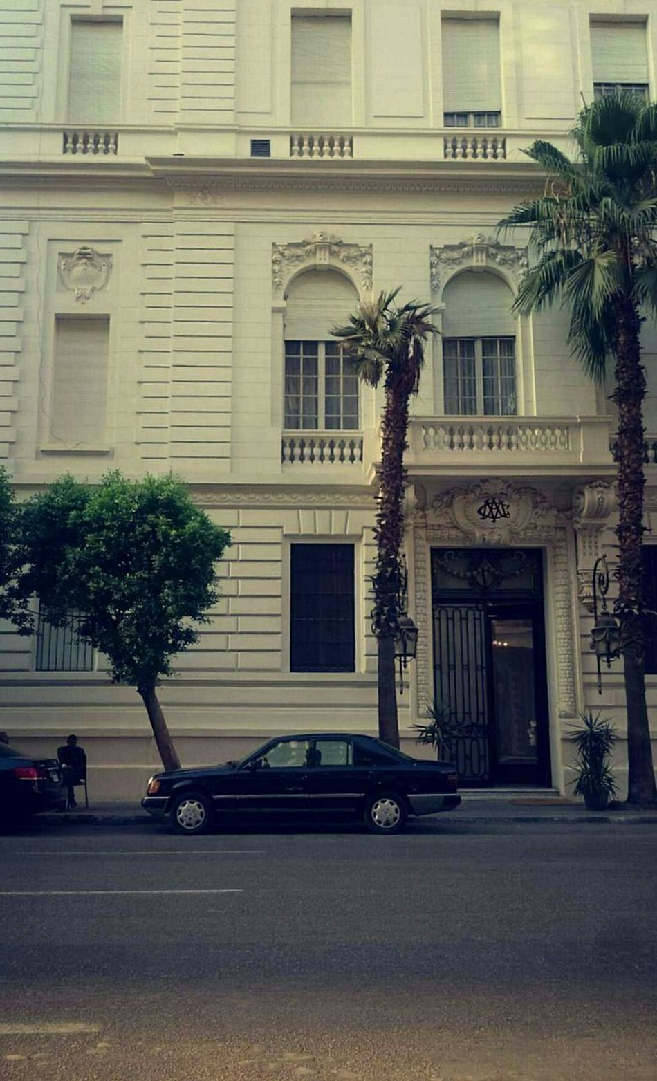 Architecture Transportation Building Exterior Car Built Structure Closed Door In Cairo Arabic Typography Taking Photos Cairo Land Vehicle Mode Of Transport Street Window City Parking Travel Shadow Road Tree In Front Of History Day Parked Outdoors