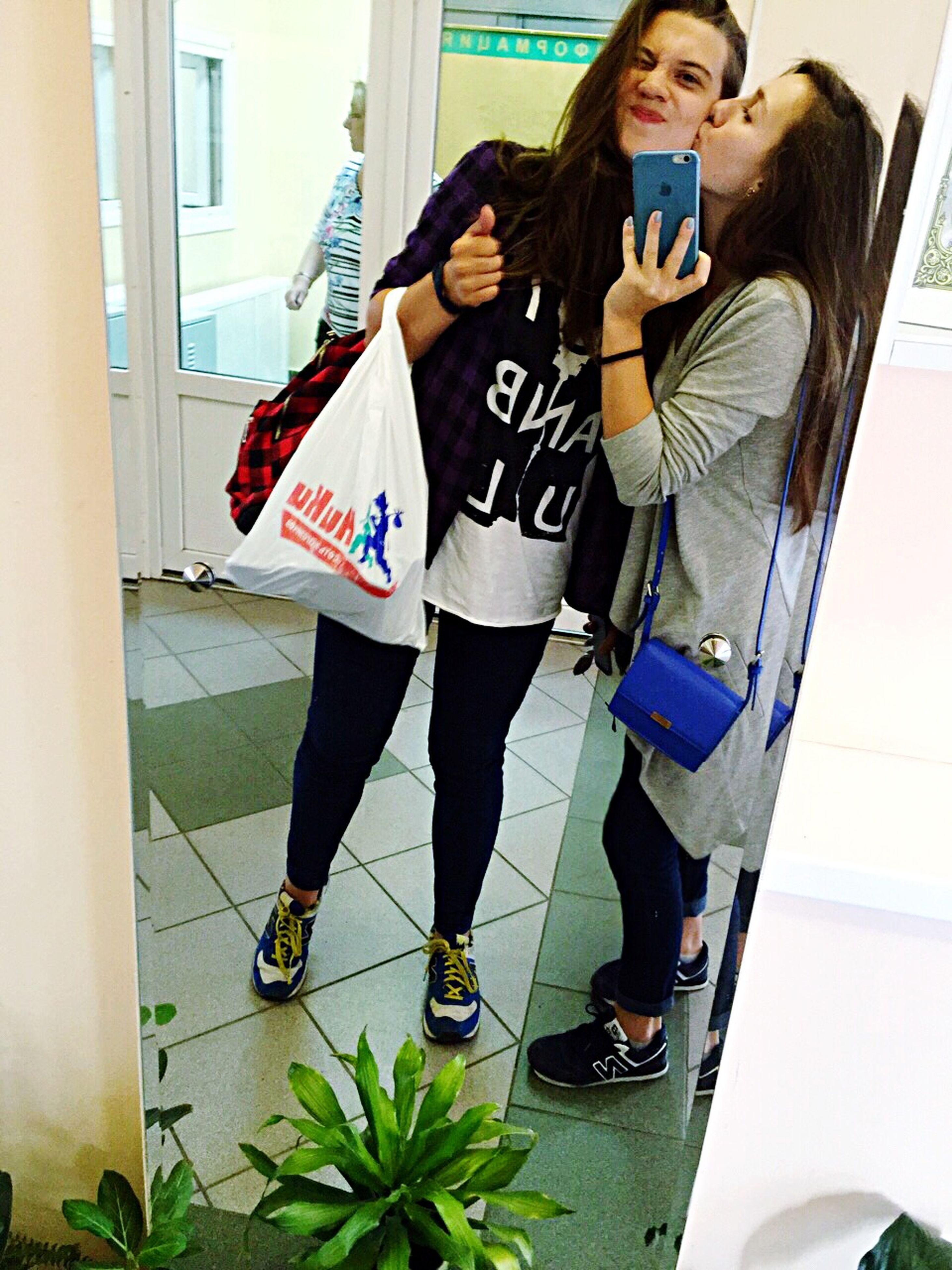 lifestyles, young adult, casual clothing, leisure activity, full length, young women, person, standing, front view, indoors, fashion, built structure, three quarter length, mirror, architecture, sitting, day, looking at camera