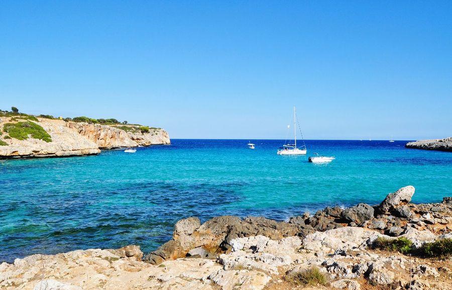 EyeEm Selects cala varques mallorca Sea Beach Sunny Water Rock - Object Travel Destinations Nautical Vessel Yacht Sky No People Idyllic Mallorca Mediterranean  Island Majorca Landscape Cala Varques