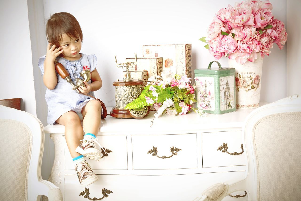 One Person Flower Baby Indoors  Babies Only Childhood People Full Length Sitting Chair Domestic Life Lifestyles Domestic Room Blond Hair Day Living Room Real People Bedroom Adult