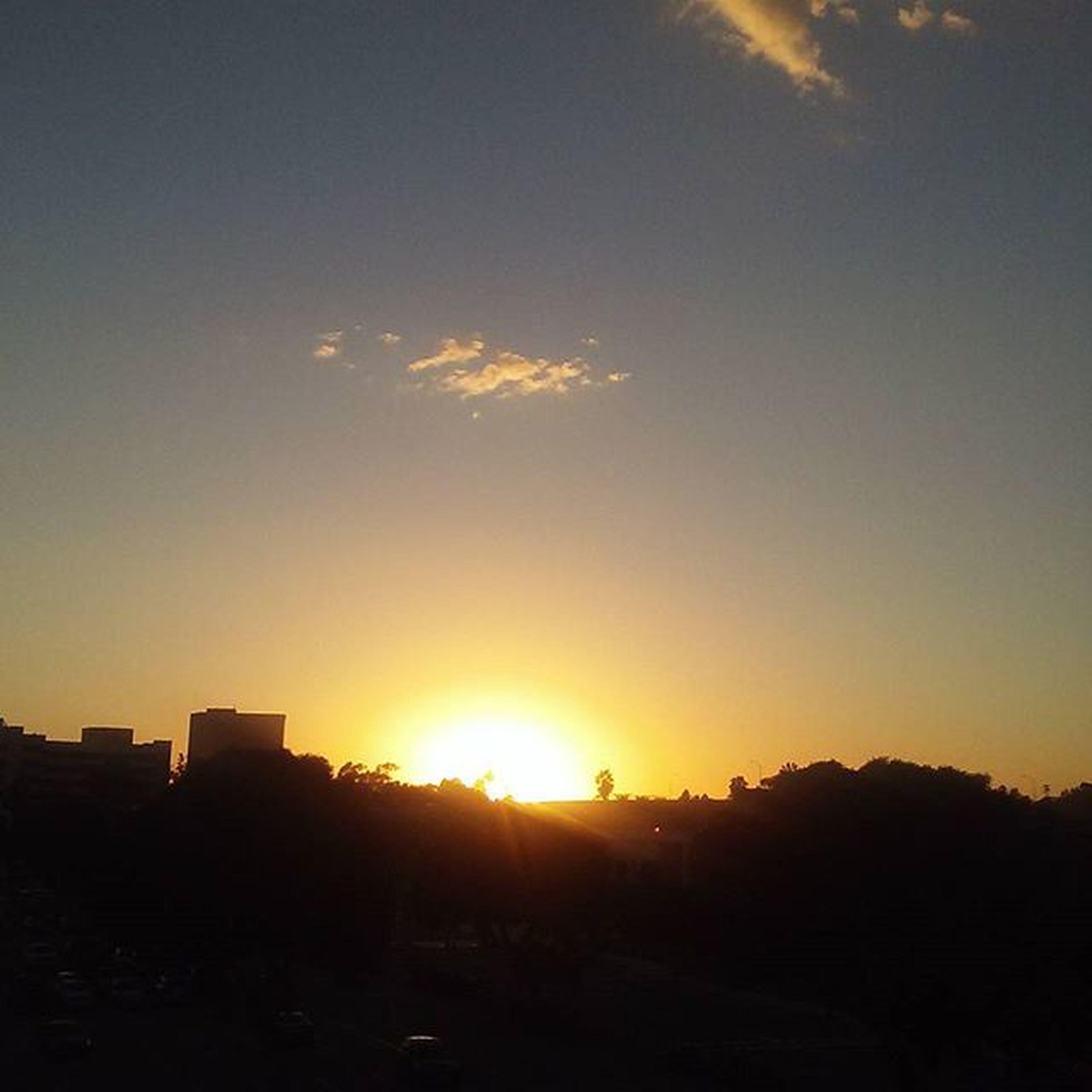 sunset, sun, silhouette, building exterior, sky, built structure, architecture, sunbeam, sunlight, scenics, beauty in nature, orange color, landscape, tranquil scene, nature, tranquility, house, cloud - sky, lens flare, idyllic