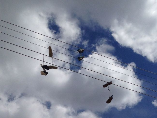 Out of the box and put in the power line Cable Cloud - Sky Day Electricity  Low Angle View No People Out Of The Box Outdoors Power Line  Shoes Sky