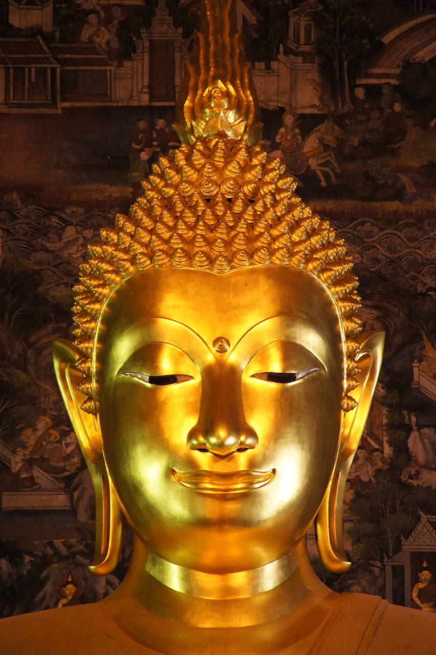 Close-Up Of Golden Buddha Statue In Temple