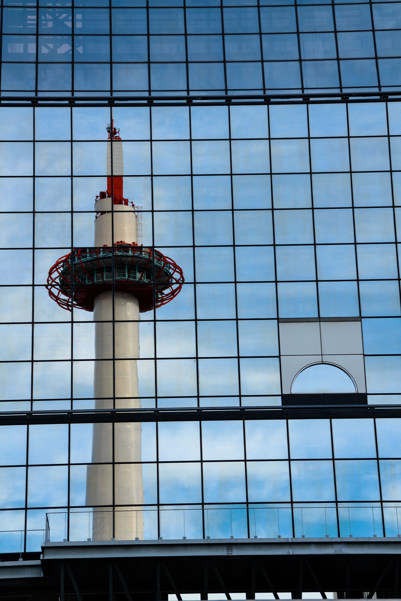 Reflection of Kyoto Tower on Kyoto Station building City Building Exterior Skyscraper Outdoors Architecture Grid No People Reflection Landmark Kyoto Tower Kyoto City Kyoto,japan