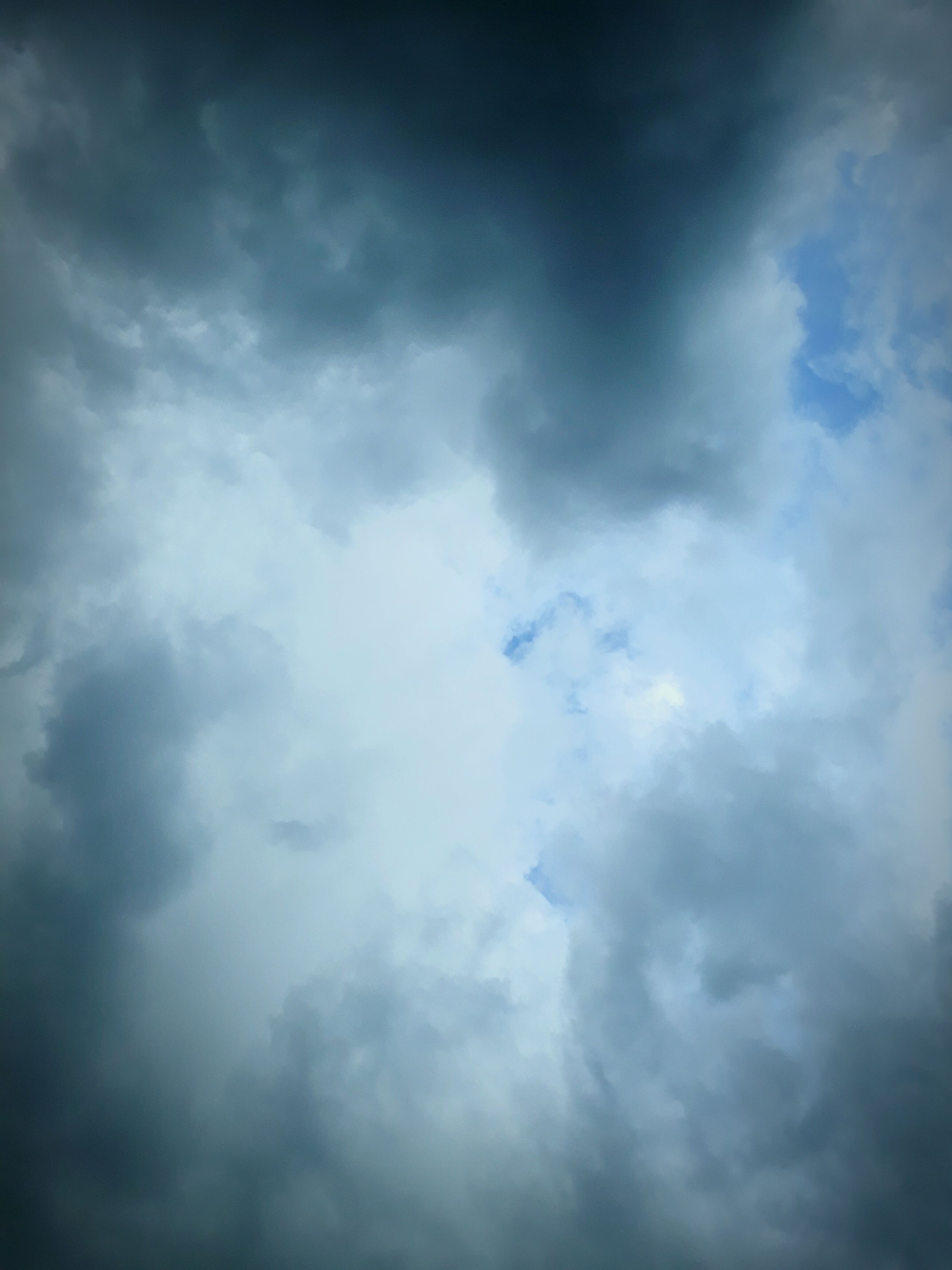 cloud - sky, nature, beauty in nature, sky, low angle view, weather, cloudscape, atmospheric mood, sky only, no people, scenics, tranquility, backgrounds, outdoors, day, tranquil scene, storm cloud, awe, blue