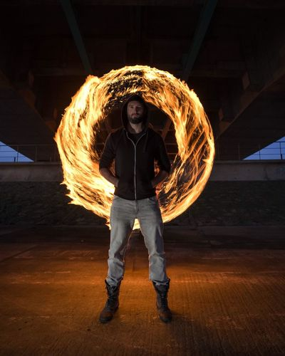 Motion One Person Night Circle Long Exposure Real People Illuminated Wire Wool Performance Standing Front View Full Length Speed Light Painting Skill  Leisure Activity Flame Sparkler Danger Activity Paint The Town Yellow