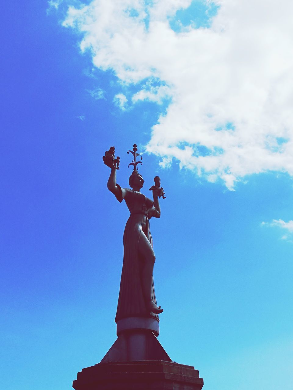 sky, statue, cloud - sky, low angle view, human representation, sculpture, female likeness, day, outdoors, architecture, no people