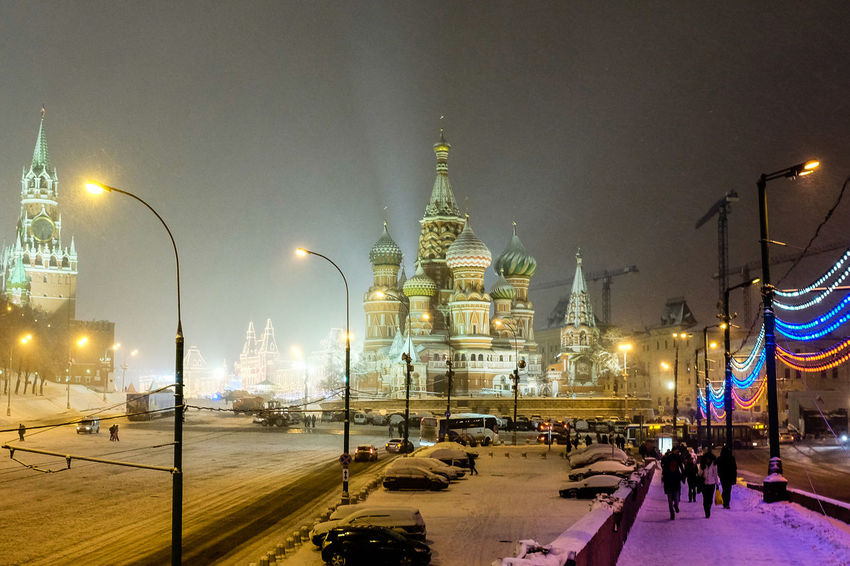St Basil's cathedral in Moscow illuminated at night Moscow Russia St Basil's Cathedral Architecture Building Exterior Built Structure City Domes Illuminated Large Group Of People Night Outdoors People Place Of Worship Real People Religion Sky Spirituality Street Light Streetlights Travel Destinations