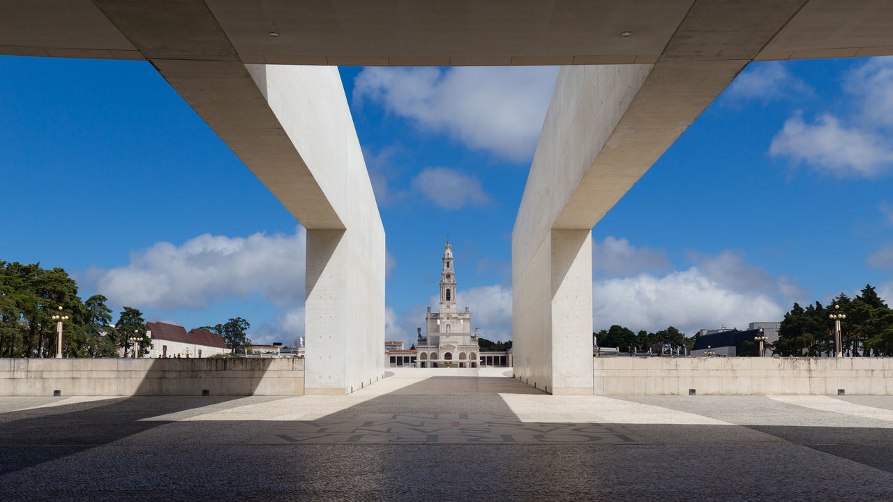 Vew of the Sanctuary of Our Lady of Fátima from the Entrance of the Basilica of the Holy Trinity, Fatima, Portugal Architecture Basilica Blue Blue Sky Catholic Catholic Church Church Churches Cloud - Sky Holy Trinity Holy Trinity Church Modern Modernist No People Our Lady Outdoors Panorama Sanctuary  SANTISSIMA Summer Trindade View