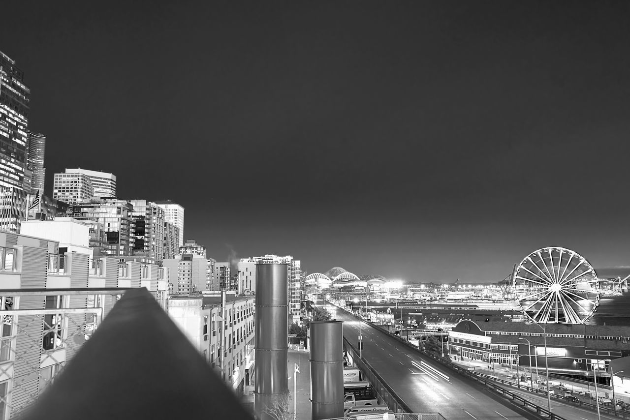 Seattle waterfront at night in black and white with copy space. Architecture Building Exterior Built Structure City City Life Cityscape Clear Sky Ferris Wheel Ferris Wheel Great Wheel Illuminated Modern Mount Rainier Night No People Outdoors Pikes Market Place Seattle, Washington Sky Skyscraper Travel Destinations Urban Skyline Waterfront