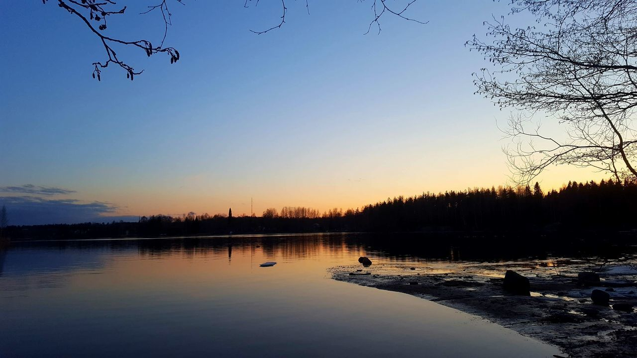 sunset, nature, beauty in nature, silhouette, tree, scenics, water, tranquil scene, tranquility, sky, reflection, no people, outdoors, lake, cold temperature, bare tree, winter, travel destinations, clear sky, bird, day