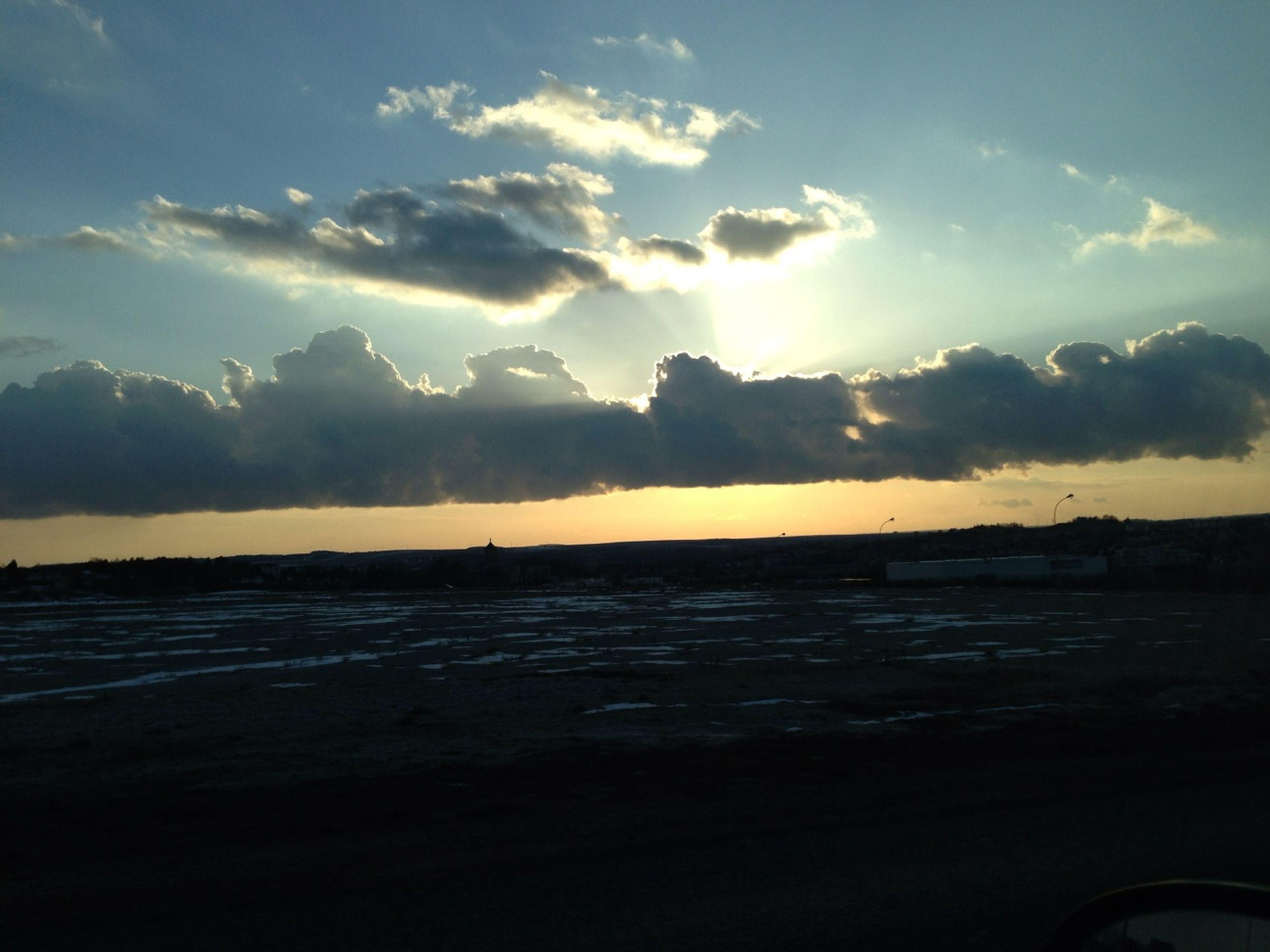 sky, water, sunset, scenics, beauty in nature, tranquil scene, tranquility, cloud - sky, mountain, sea, nature, idyllic, lake, silhouette, sunlight, sun, reflection, cloud, transportation, mode of transport