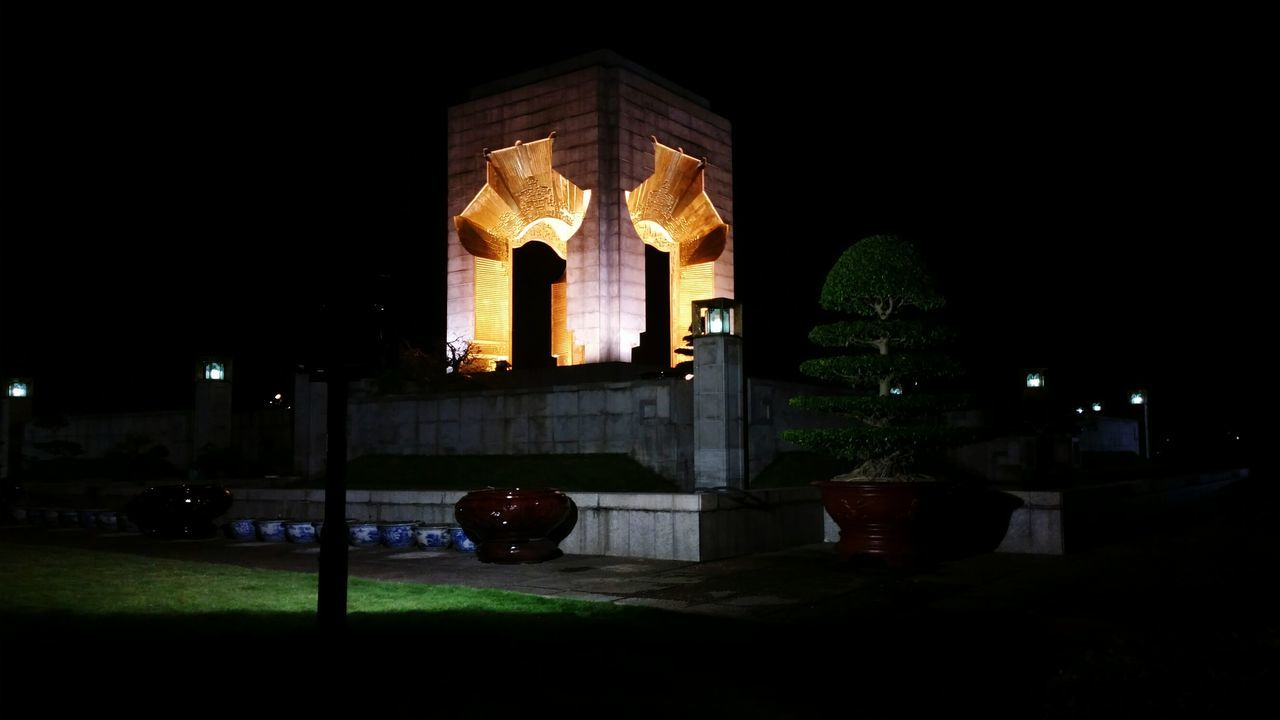 architecture, built structure, night, building exterior, illuminated, no people, statue, sculpture, outdoors, city, sky