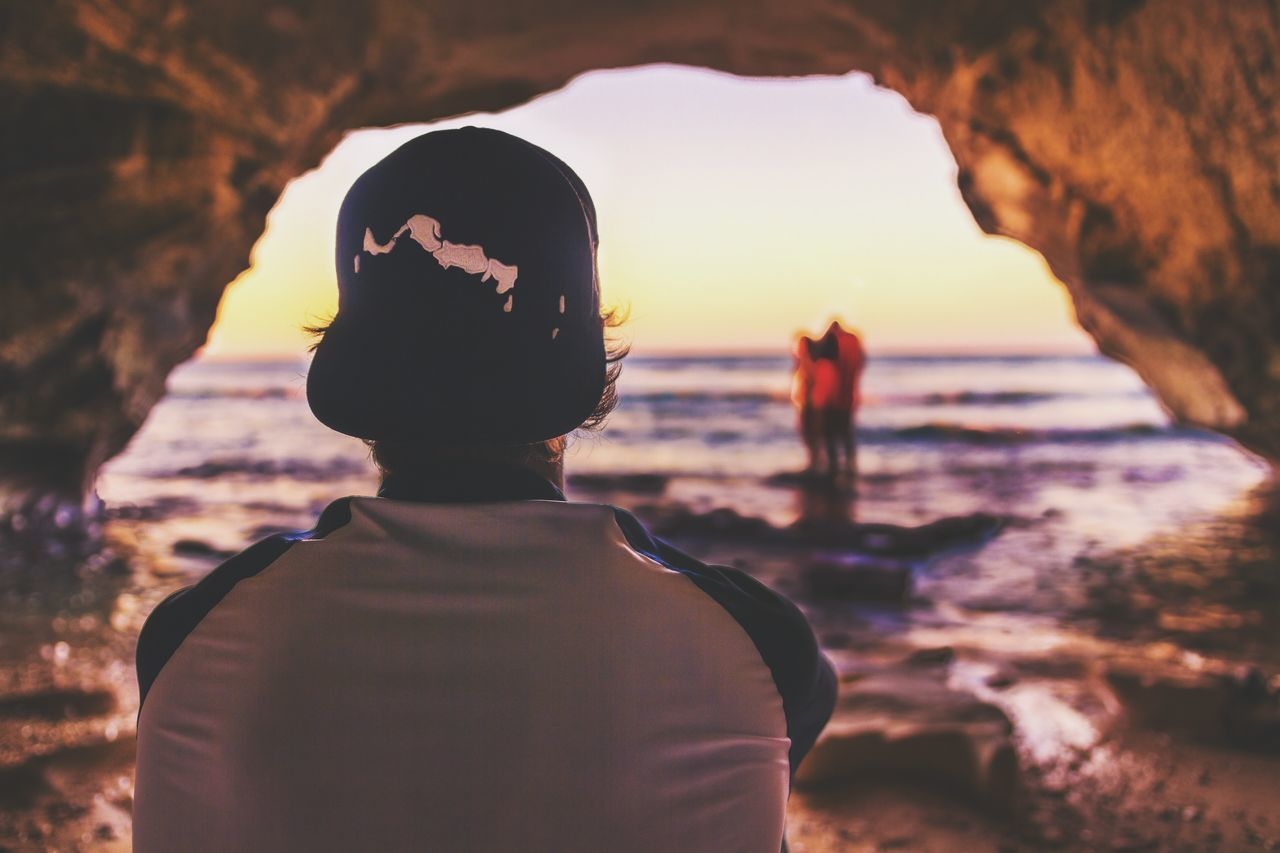 rear view, sunset, two people, real people, sea, water, leisure activity, standing, nature, beach, women, lifestyles, men, vacations, togetherness, beauty in nature, outdoors, scenics, friendship, sky, young women, wave, horizon over water, day, young adult, adult, people