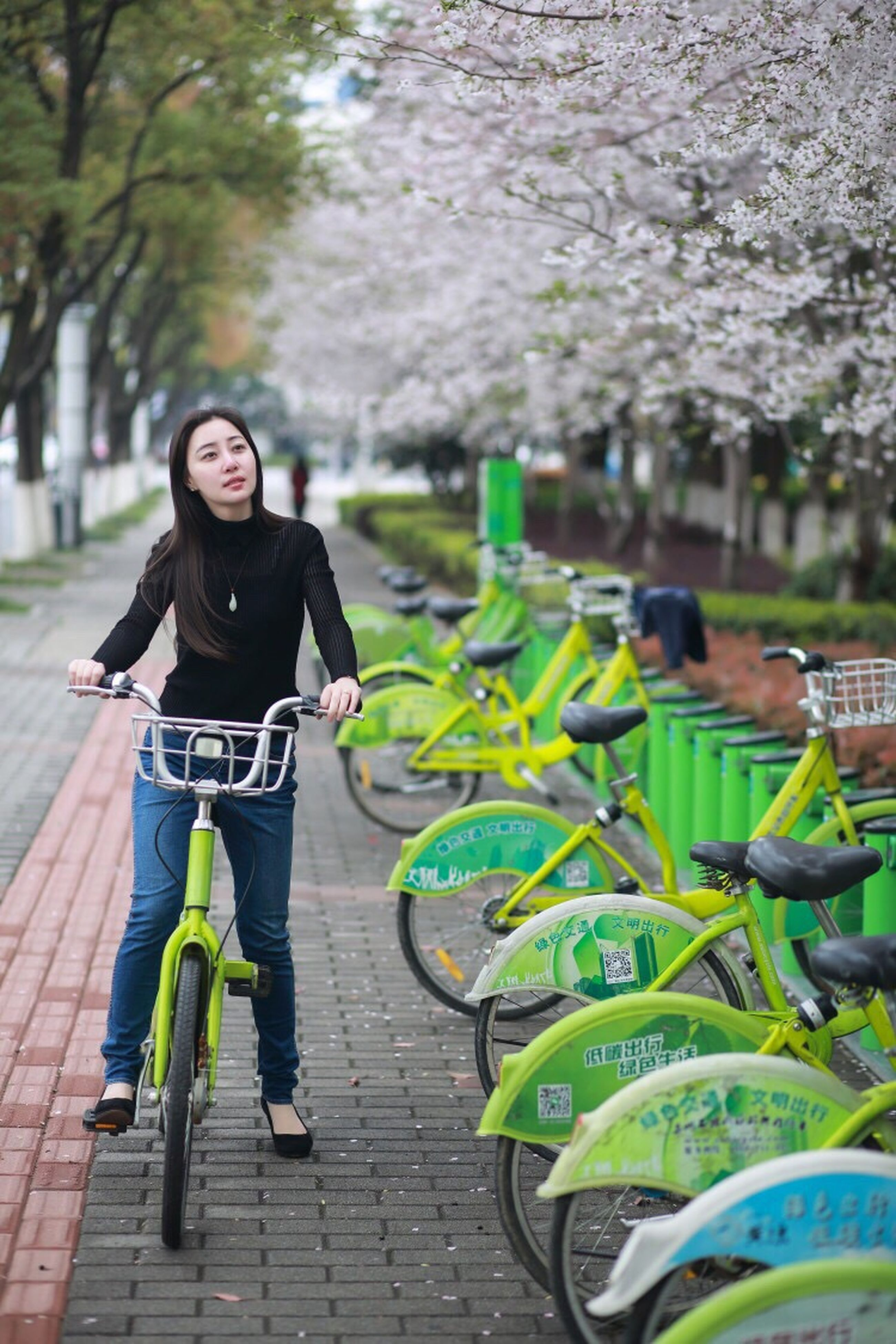 casual clothing, bicycle, one person, portrait, city, one woman only, full length, young adult, people, outdoors, adults only, one young woman only, adult, only women, young women, real people, women, happiness, cheerful, day, nature