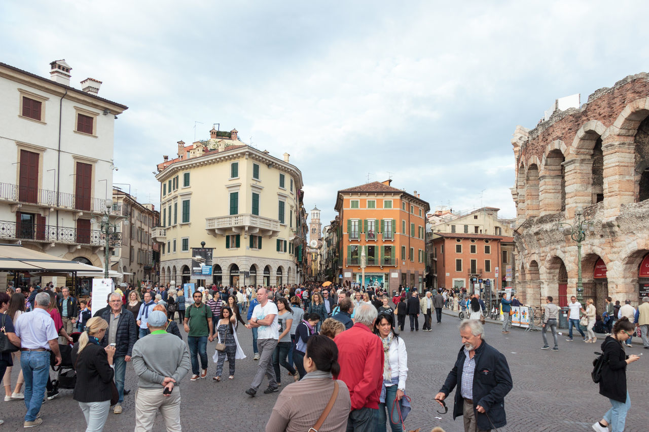 Verona, Italy - September 26, 2015 : Tourists walking around the Piazza Bra square, inspect the Arena and take pictures against its background in Verona, Italy. Architecture Architecture Art Building City Culture Day Europe Famous History House Italy Landmark Old Outdoors People Square Street Tourism Town Travel Urban Verona View Walking