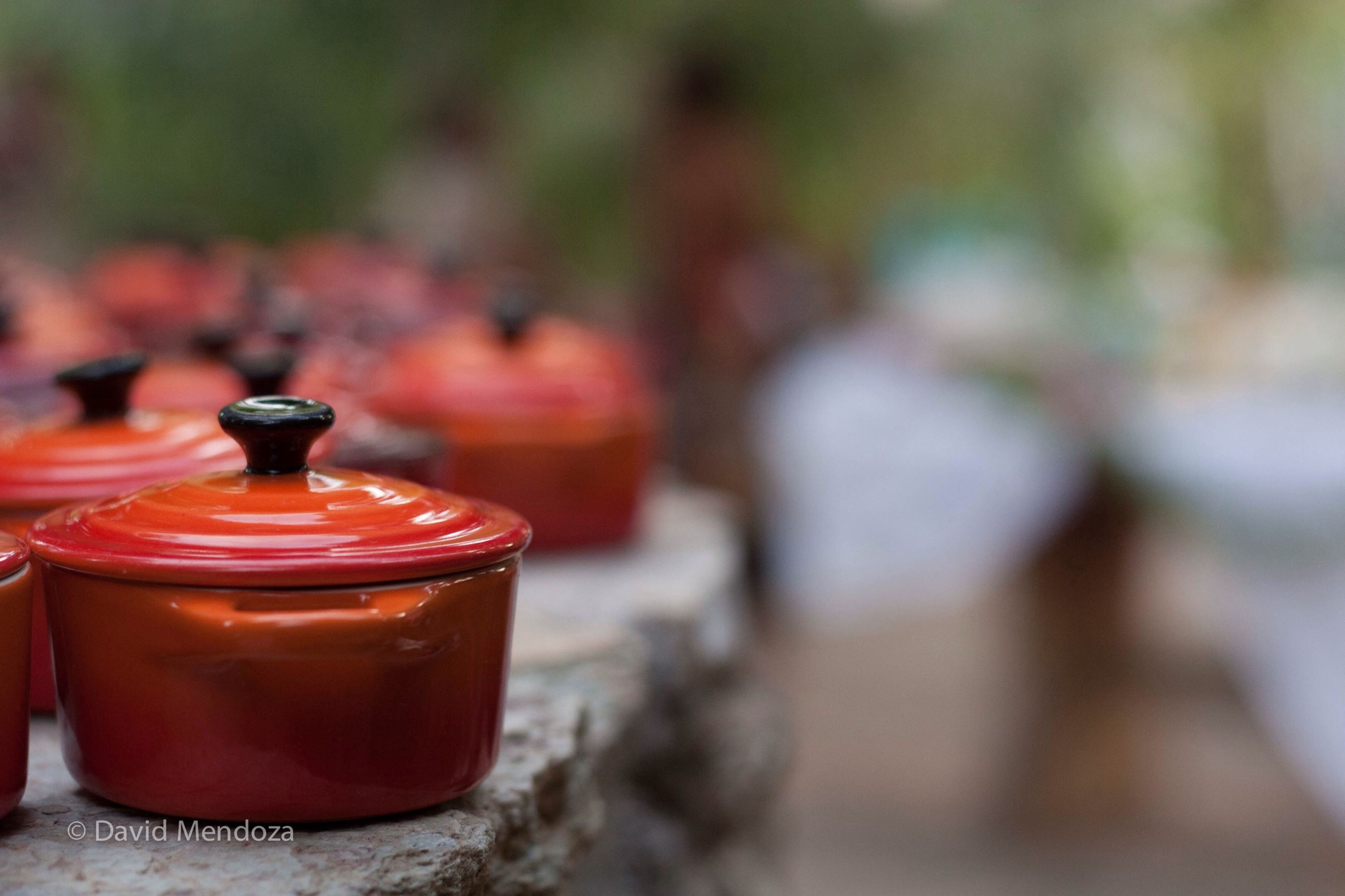 red, focus on foreground, close-up, selective focus, drink, food and drink, refreshment, freshness, still life, day, outdoors, bottle, container, table, cold temperature, glass - material, no people, burning, candle