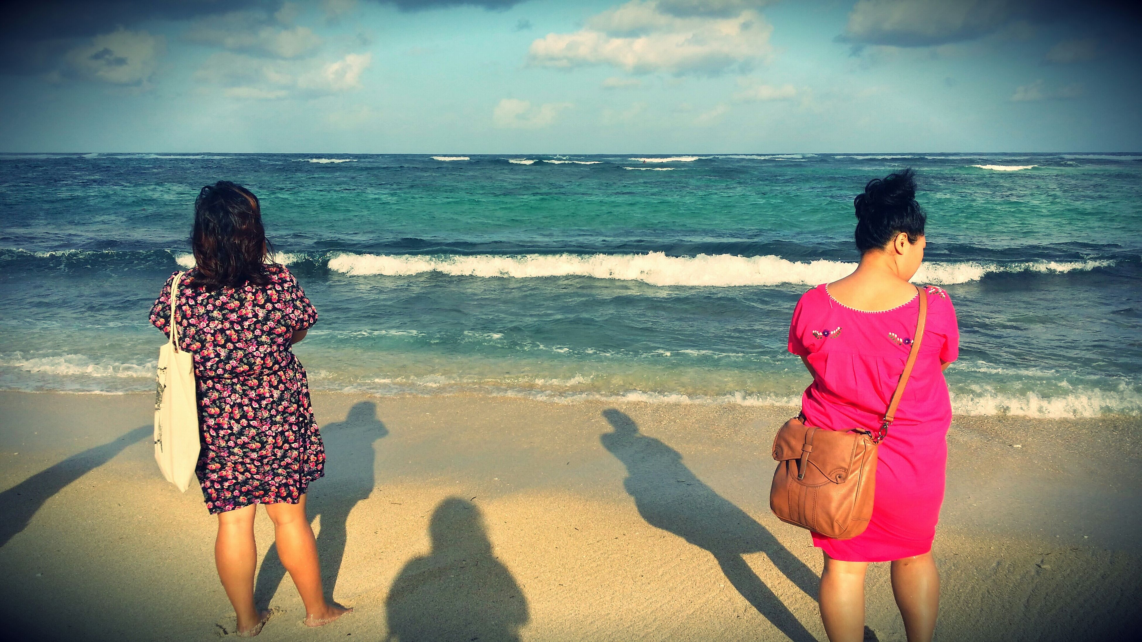 sea, water, beach, lifestyles, sky, horizon over water, leisure activity, standing, shore, rear view, full length, togetherness, casual clothing, cloud - sky, love, childhood, bonding, vacations