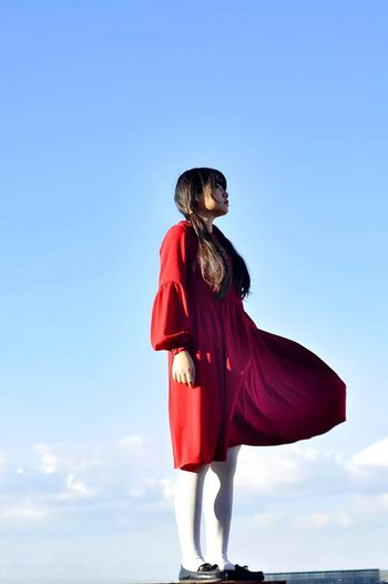 girl and sky Cape  Full Length Superhero Blue Heroes One Girl Only One Person Red Fantasy Girls Beauty People Women Outdoors Sky Young Adult Day Adult Period Costume