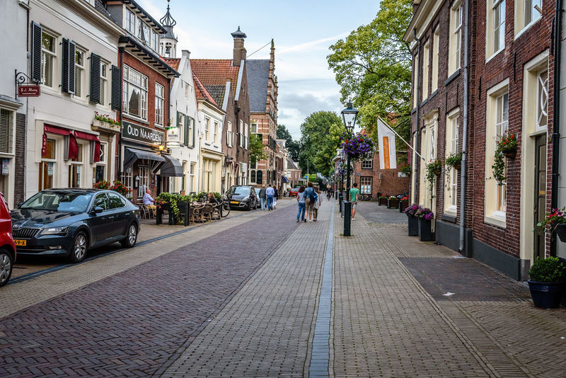 Cityscape of Naarden Architecture Building Exterior Built Structure Car City City Cityscape Cityscapes Day Fortress Garrison Incidental People Land Vehicle Outdoors People Real People Sky Street The Way Forward Tourism Town Transportation Travel Destinations Tree Tree