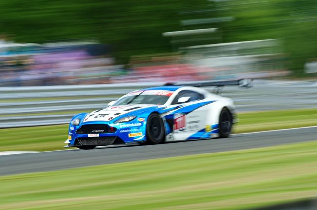 Capturing Motion Aston Martin Blurred Motion Speed Auto Racing Motor Racing Track Sports Race Motorsport Car Multi Colored Racecar Competition No People Sports Track Close-up Day Outdoors Horizontal Land Vehicle Grass Speed Limit
