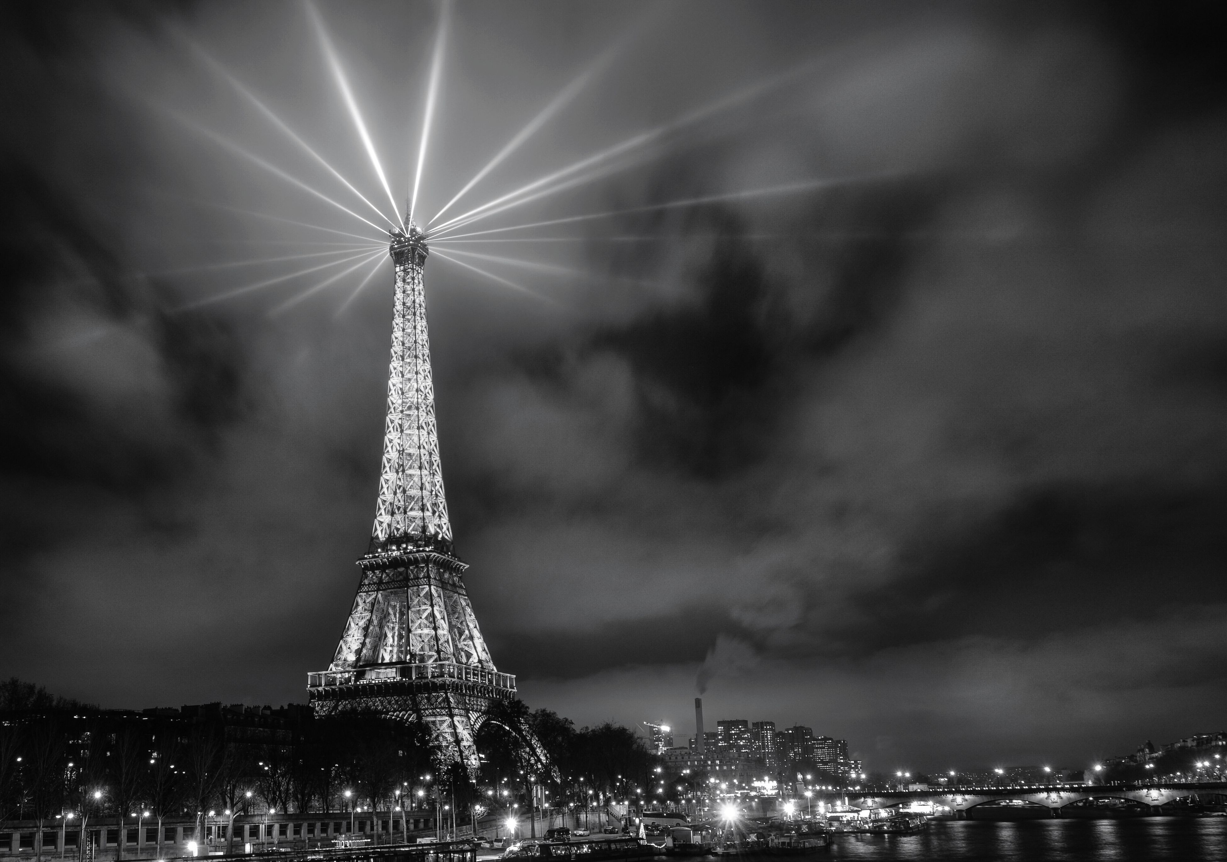 night, architecture, built structure, international landmark, travel destinations, illuminated, sky, famous place, city, capital cities, tourism, travel, eiffel tower, building exterior, cityscape, tall - high, tower, low angle view, cloud - sky, dusk