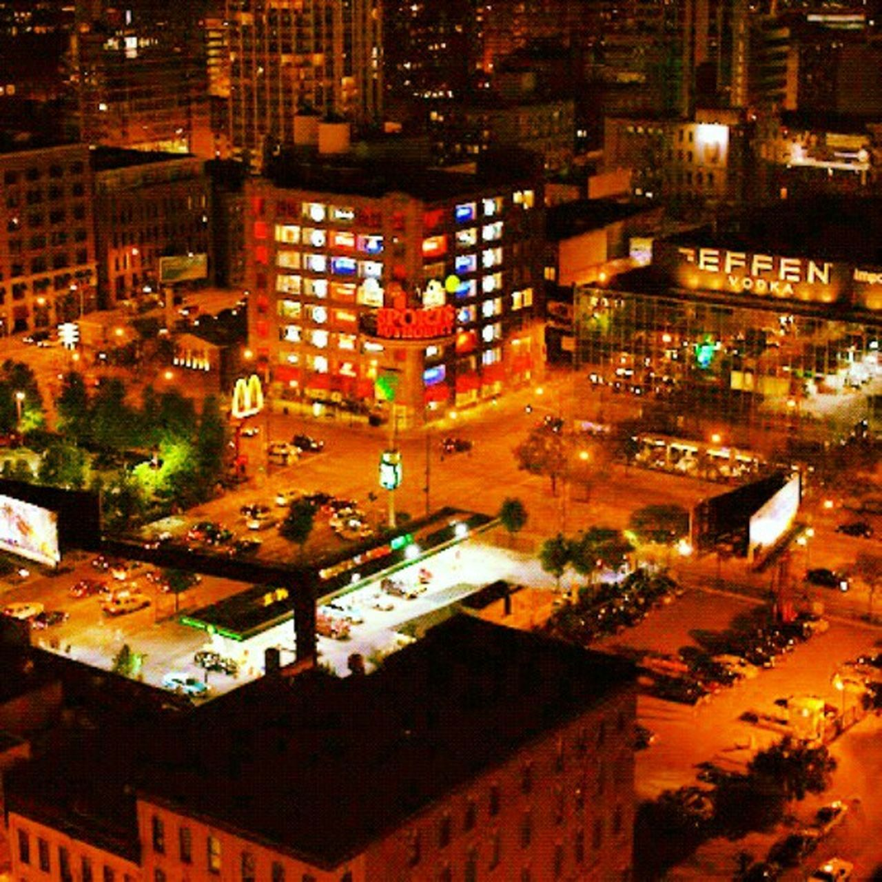 city, illuminated, night, high angle view, cityscape, building exterior, architecture, city life, street, outdoors, road, built structure, no people, nightlife, skyscraper, urban skyline