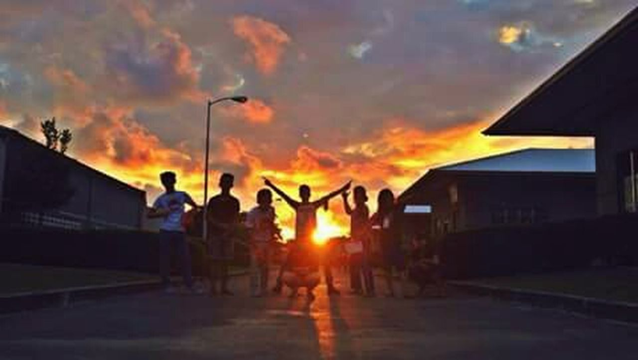 sunset, built structure, building exterior, cloud - sky, architecture, outdoors, sky, night, people, adult, adults only, men, large group of people, only men, young adult