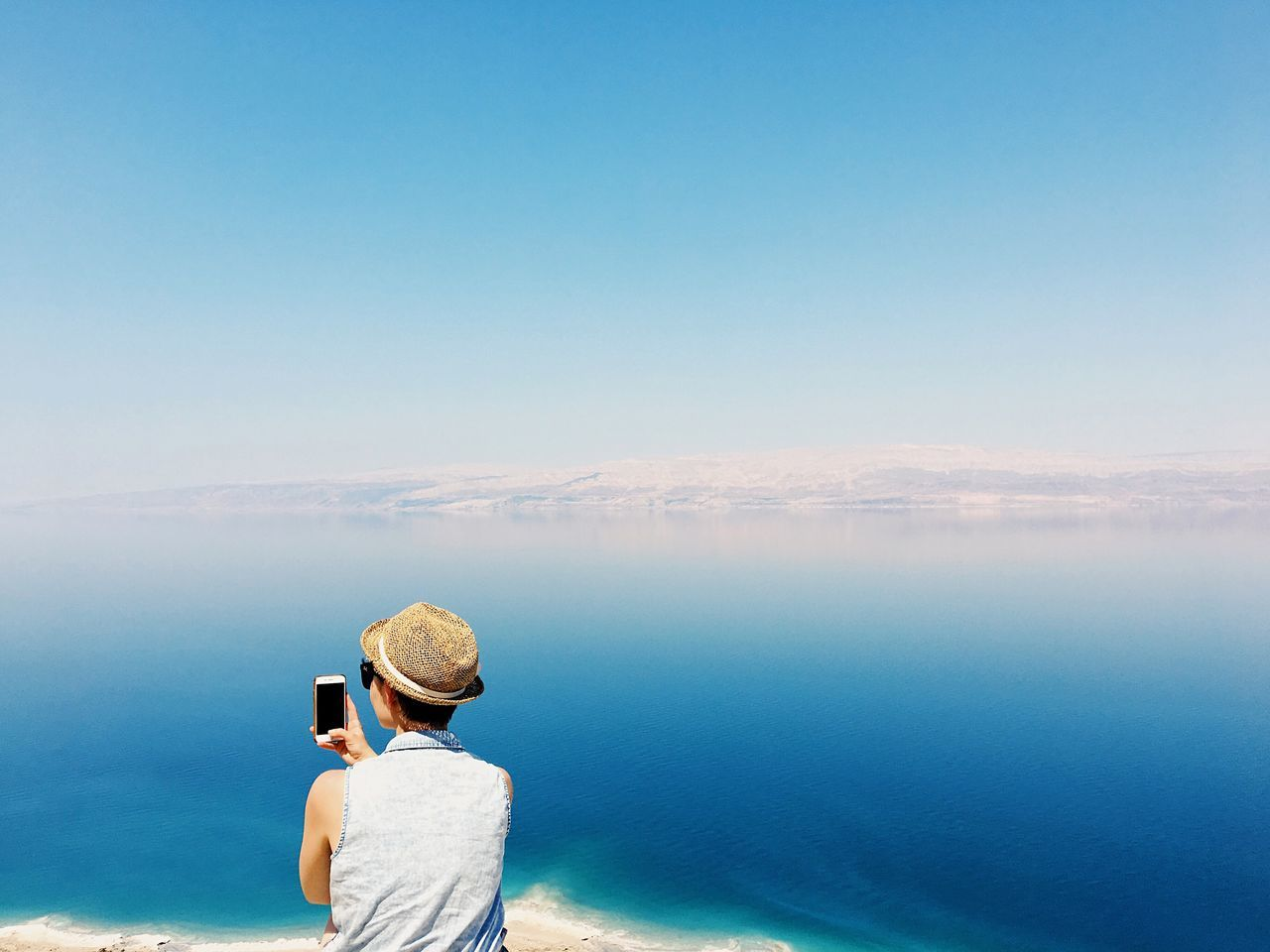 The view that amaze me every time Rear View Water Real People Wireless Technology Leisure Activity Lifestyles Sea Technology Nature Photographing One Person Scenics Beauty In Nature Mobile Phone Tranquil Scene Women Outdoors Standing Tranquility Day Dead Sea  Dead Sea View Dead Sea Jordan Dead Sea Israel Seating