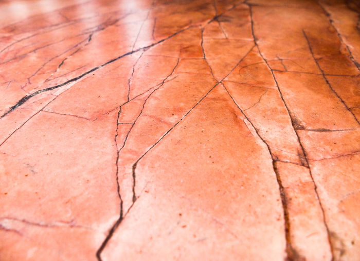 Abstract Close-up Floor Focus On Foreground Marble Pink Color Salmon Colored Seam Selective Focus Vein