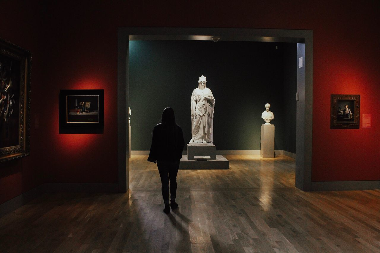 human representation, statue, art and craft, museum, indoors, sculpture, real people, illuminated, full length, architecture, day