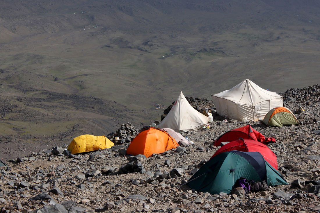 Colorful tents in the mountaineer high camp at mount Ararat in front of the grey plains in the background, Turkey Colors Desert High Hiking Mountaineering No Sky Rocky Trekking Adventure Ararat  Ağrı Dağı Camp Camping Climbing Colorful Erosion Extreme Sports Kurdistan Landscape Mountain Outdoors Plain Scenics Tent Tents