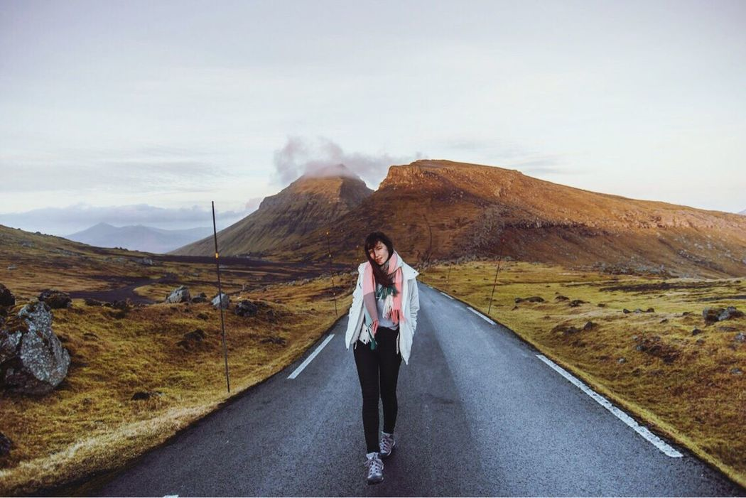 Faroe Islands Mountain One Person Outdoors Road Young Adult Mountain Range Nature Sky People Landscape Beauty In Nature Roadtrip Hiking Traveling Traveler Travel Destinations Travel Photography Second Acts