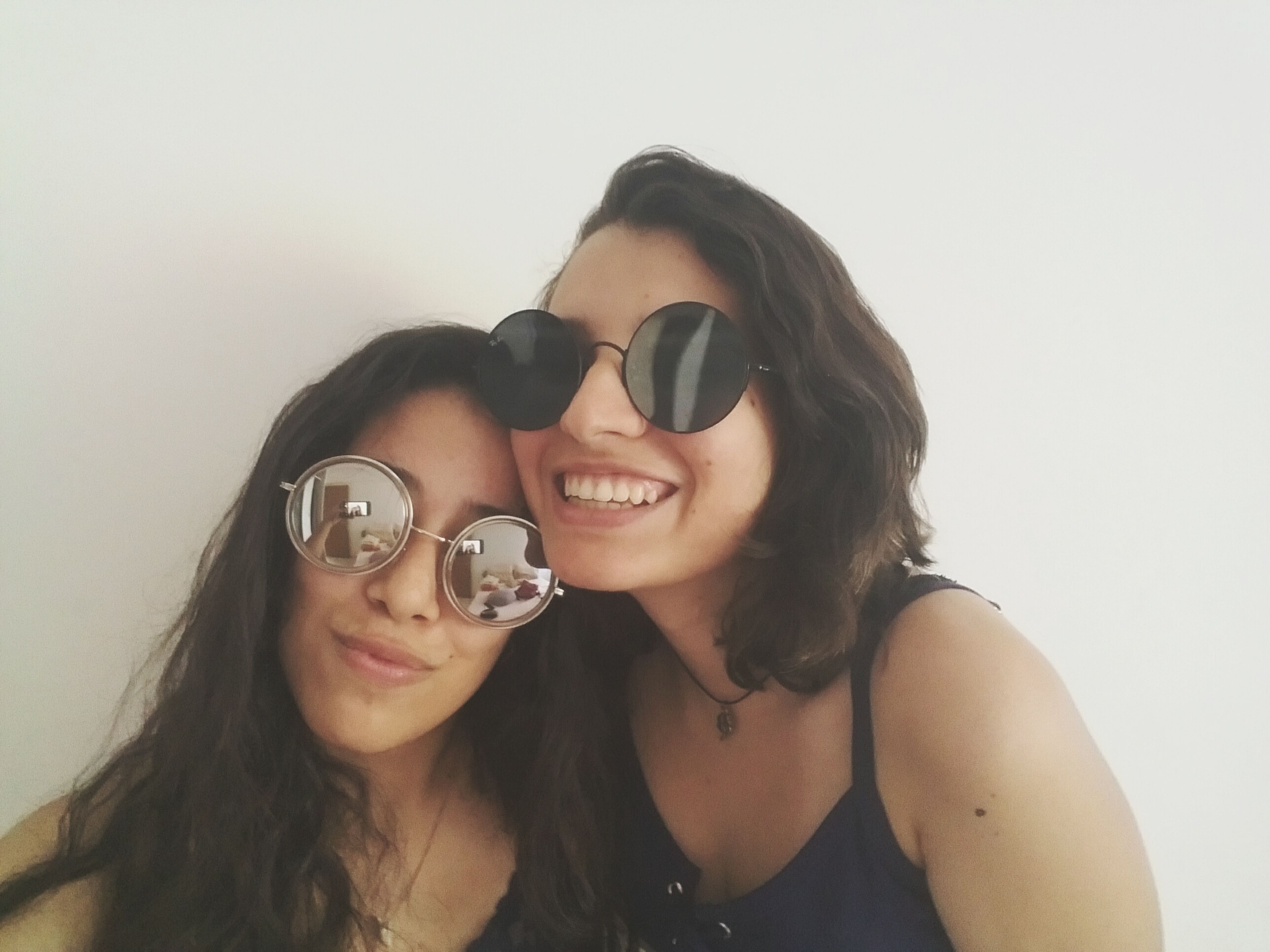two people, smiling, real people, photography themes, lifestyles, portrait, happiness, sunglasses, technology, cheerful, looking at camera, young women, young adult, togetherness, leisure activity, women, selfie, bonding, indoors, people, adult, day