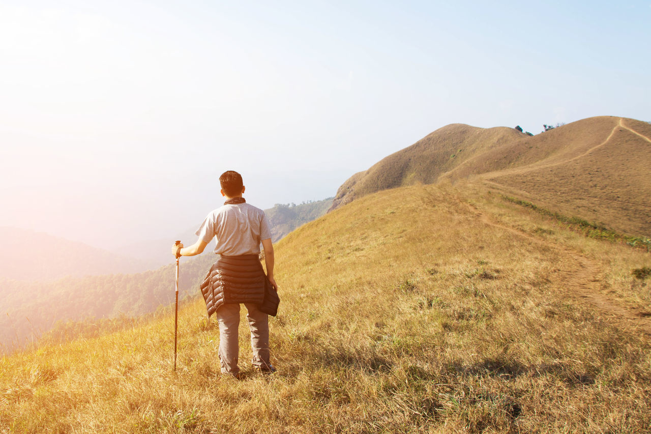Adult Adults Only Adventure Beauty In Nature Day Full Length Grass Hiking Landscape Leisure Activity Men Mountain Nature One Man Only One Person Only Men Outdoors People Sky Standing Travel Vacations