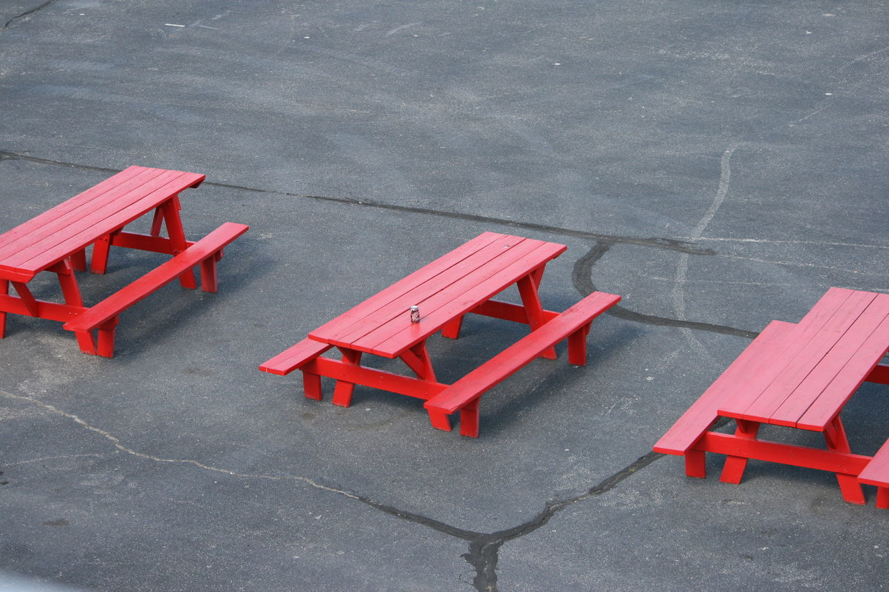 1 Can 1 Can On Table 3 Tables Asphalt Day High Angle View No Filter No Edit No People Outdoors Picnic Tables Red Red Picnic Tables Red Tables