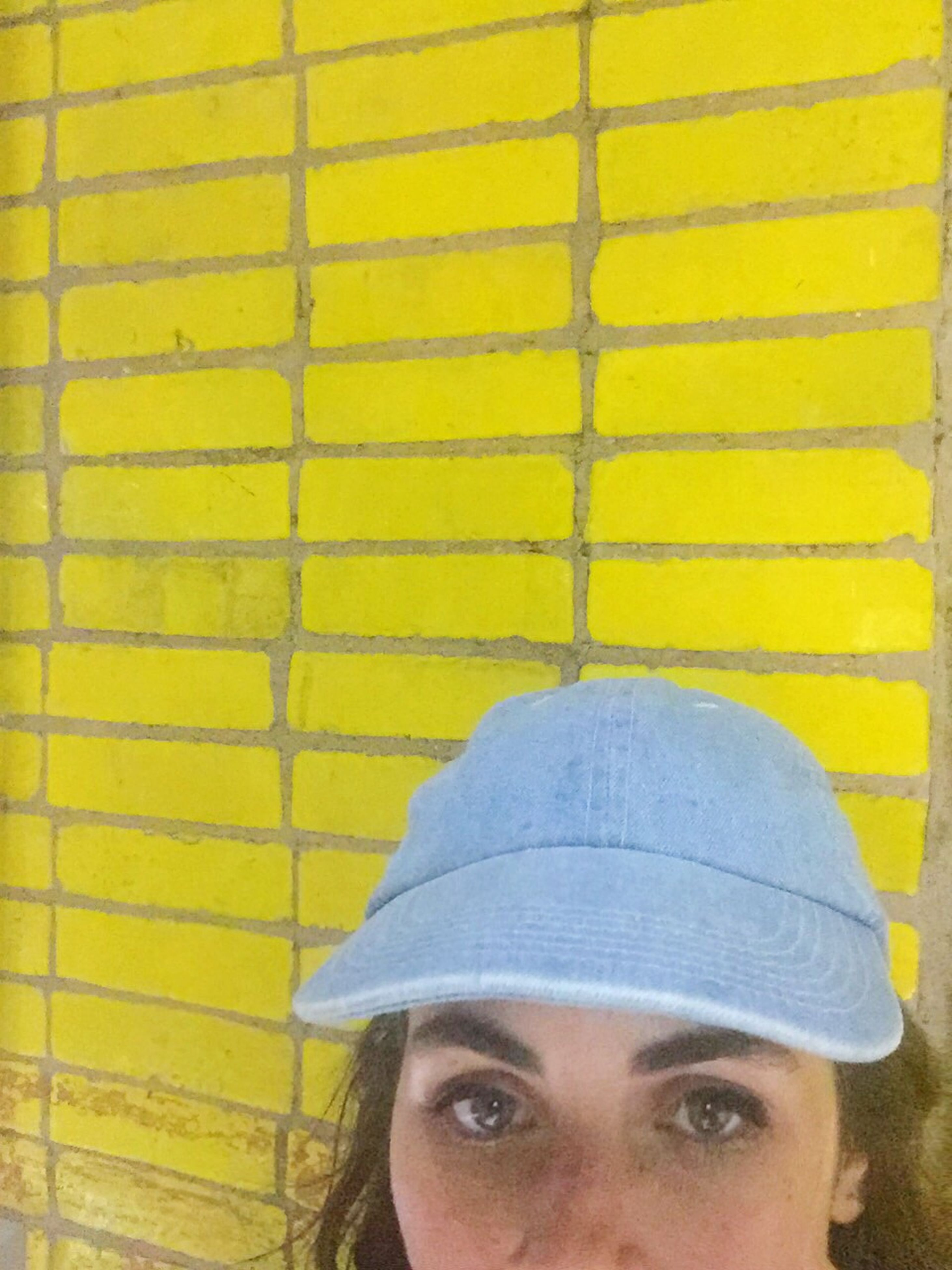 yellow, lifestyles, close-up, headshot, leisure activity, day, outdoors, casual clothing, portrait, blue
