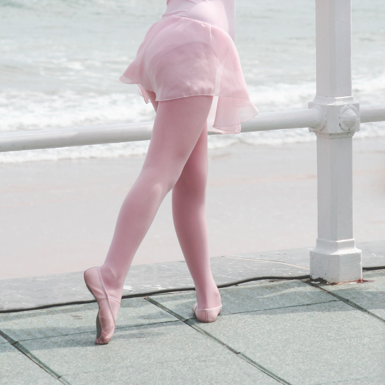 A girl in ballet class in the beach Ballerina Ballet Ballet Class Ballet Dancer Ballet Shoes Body Part Close-up Clothing break the Mold Feet Focus On Foreground Girl Human Legs Leisure Activity Lifestyles Outdoors Part Of Pink Color Pretty Promenade Sea Water break the mold