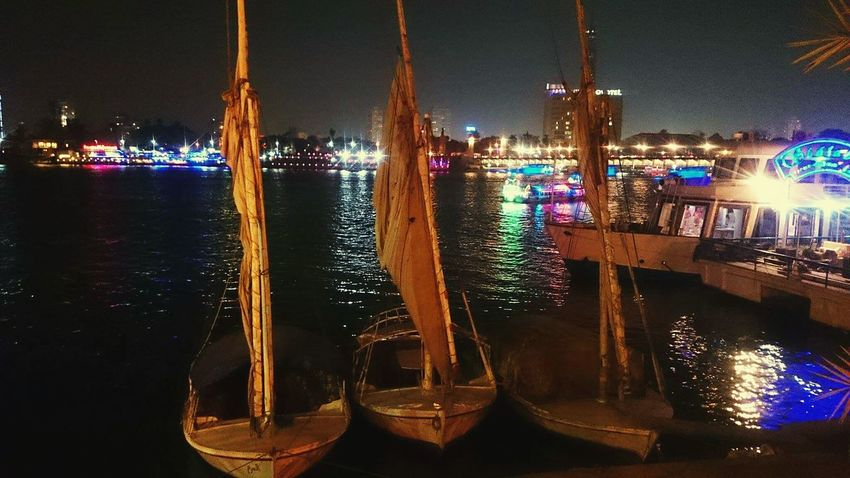On The Riverside Boats⛵️ Nile River Cairobeauty River At Night Night Lights Sails Eyem City Shots View Over River EyeEm Best Shots My Point Of View Amazing View Check This Out Walking Around Beauty Welcome To Black
